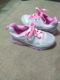 white-and-pink running shoes