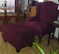 two brown wooden framed red padded armchairs Ocala