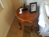 brown wooden round side table Henderson