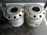 four gray steel car wheel rims