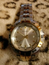 round silver-colored analog watch with link bracelet 70 km
