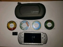 Silver PSP with games and movies