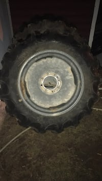 Gray vehicle wheel with tire