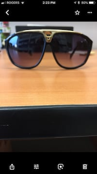 Louis Vuitton Black framed sunglasses. Montréal, H1G 2J4