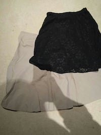 two white and black mini skirts