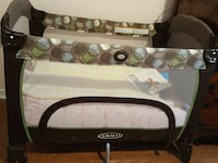 baby's black and gray Graco pack n play Toronto, M2N 3K8