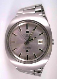 round silver Tissot watch with silver link b