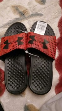 pair of black-and-red Under Armour slide sandals