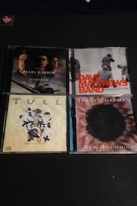 Four assorted cd cass five CDs total for only nine dollars Everett, 98201