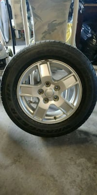 One only *Wrangler tire and rim.  P235. 65R17