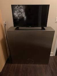 Black and gray flat screen tv with stainless steel stunning stand Toronto, M4Y 1W3