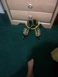 pair of yellow-and-black inline skates
