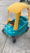 blue and yellow Fisher Price ride on toy