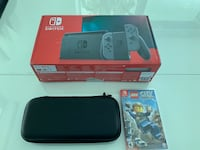 Nintendo Switch Console with Gray Joy-Con (V2)+ Carrying case + Extras