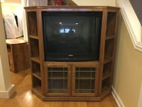 brown wooden TV hutch and flat screen television CHICAGO