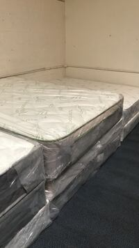 white-and-gray floral bed mattresses