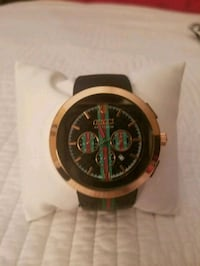 round gold chronograph watch with brown leather strap Pembroke Pines