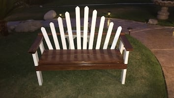 Brown and white wooden bench.