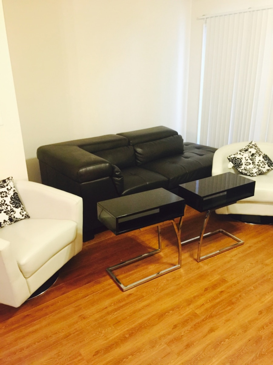 Used Black Leather Sectional Two White Leather Spinning