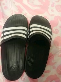 pair of black-and-white adidas slide sandals Myrtle Beach
