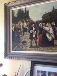Brown wooden framed painting of people Toronto, M1L 3Y1