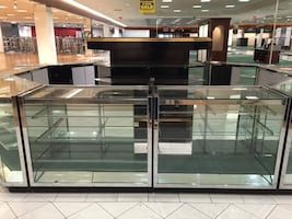 Store Display Showcase Glass cabinet case.  Heavy duty glass. Solid chrome edges. High end