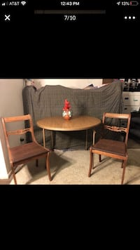 Brown folding round table and two antique mcm chairs Alexandria, 22306