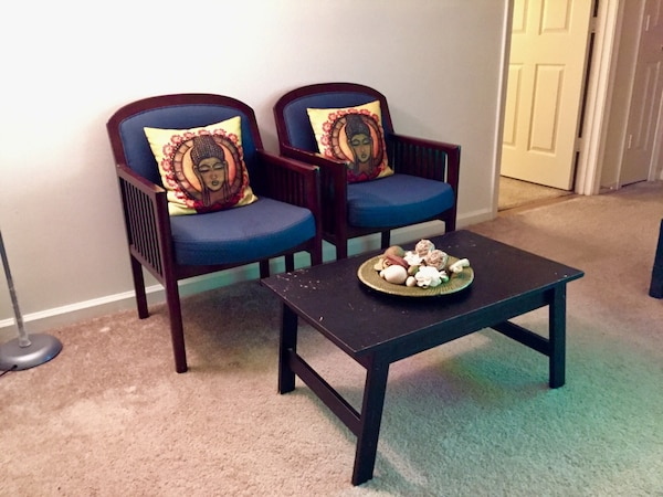 Black wooden table with chairs and cushions 6a9969e1-5c04-44c5-9953-612516345ca2