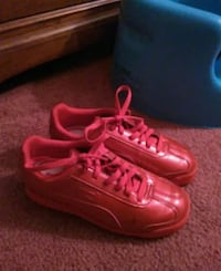 pair of red leather sneakers Winterville, 28590