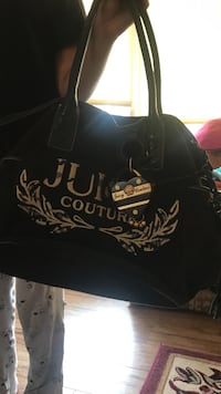 black and brown Juicy Couture leather tote bag
