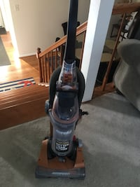 Black and gray eureka upright vacuum cleaner