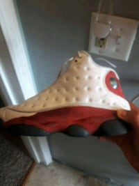 unpaired white and red Air Jordan 13 shoe Toledo, 43612