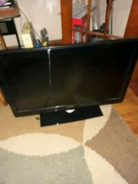black flat screen TV with remote Springfield, 01104