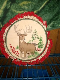 Cloth wall peice with deer on it