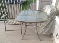 Round white metal framed glass top patio table Surrey, V3Z 1E3