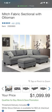 Grey L Shaped Sectional couch with ottoman.