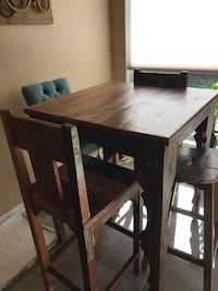 rectangular brown wooden table with four chairs dining set Sugar Land, 77478