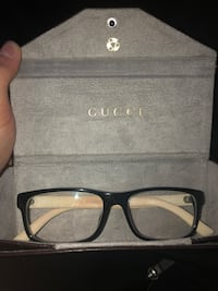 black framed Gucci eyeglasses in case Toronto, M6H 2G4