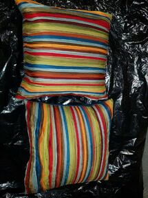 2 red green and blue striped throw pillows