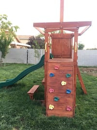 Out side play house still in good condition. We but this brand new 2 1/2 years ago. Kids love this play house and so do adults lolol. Buyer will be responsible for the removing of this play house and it is also a name brand. It is missing the tarp that it Henderson