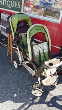 baby's white and green tandem stroller Providence, 02909