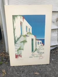 white wooden framed painting of house Montreal
