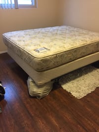 Gently used firm mattress set (queen)