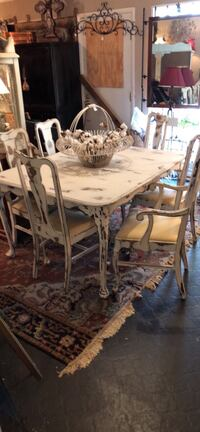 Distressed dining room table. 6 chairs. 1 arm chair. Newly Uphlostery
