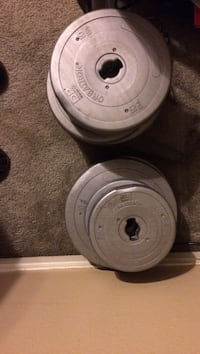 Cement weights. Have bench with leg extension attachment (no bars)