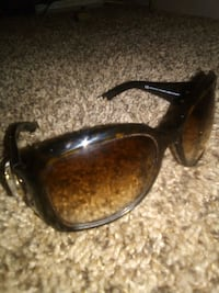 brown framed sunglasses with case 1815 mi