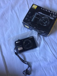 Black nikon coolpix point-and-shoot camera Calgary, T2K