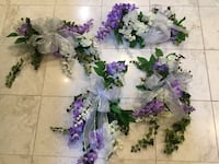 White and purple flower bouquets for trellis, white bows w/pearl strands for pews/chairs for wedding Southfield, 48033