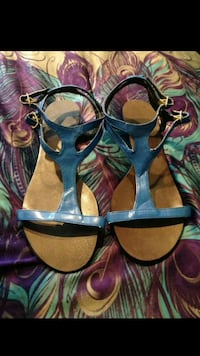 pair of blue-and-brown leather ankle strap sandals