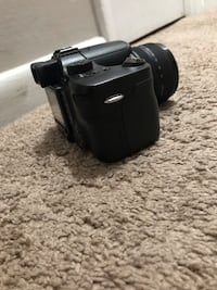 Black and gray dslr camera I lost  the battery the battery is easy to get Herndon, 20170